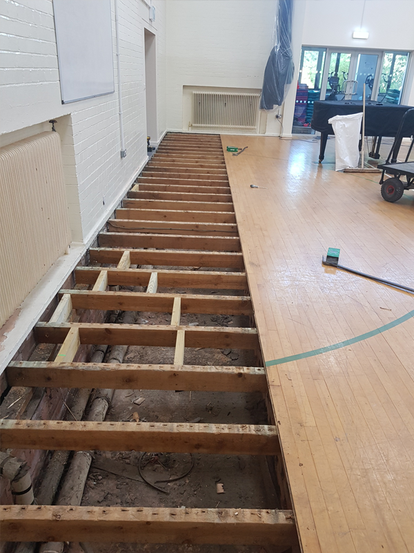 Image of replacement block flooring being laid